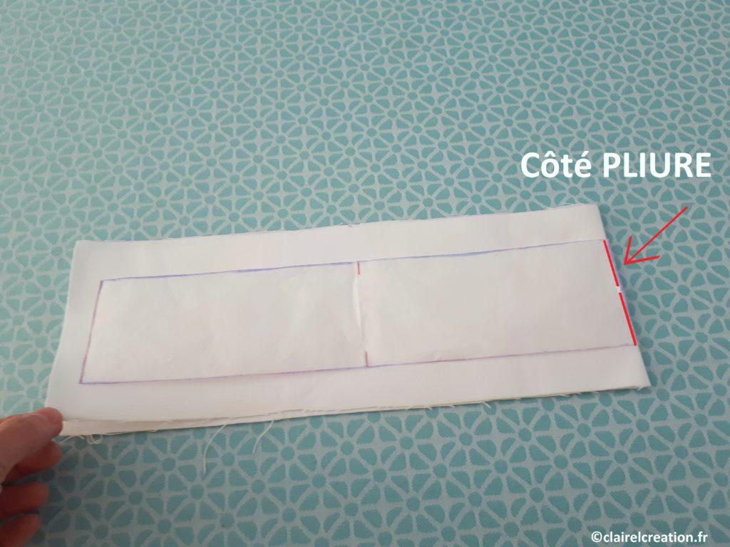 Positionner le patron de la ceinture sur le tissu plié en deux